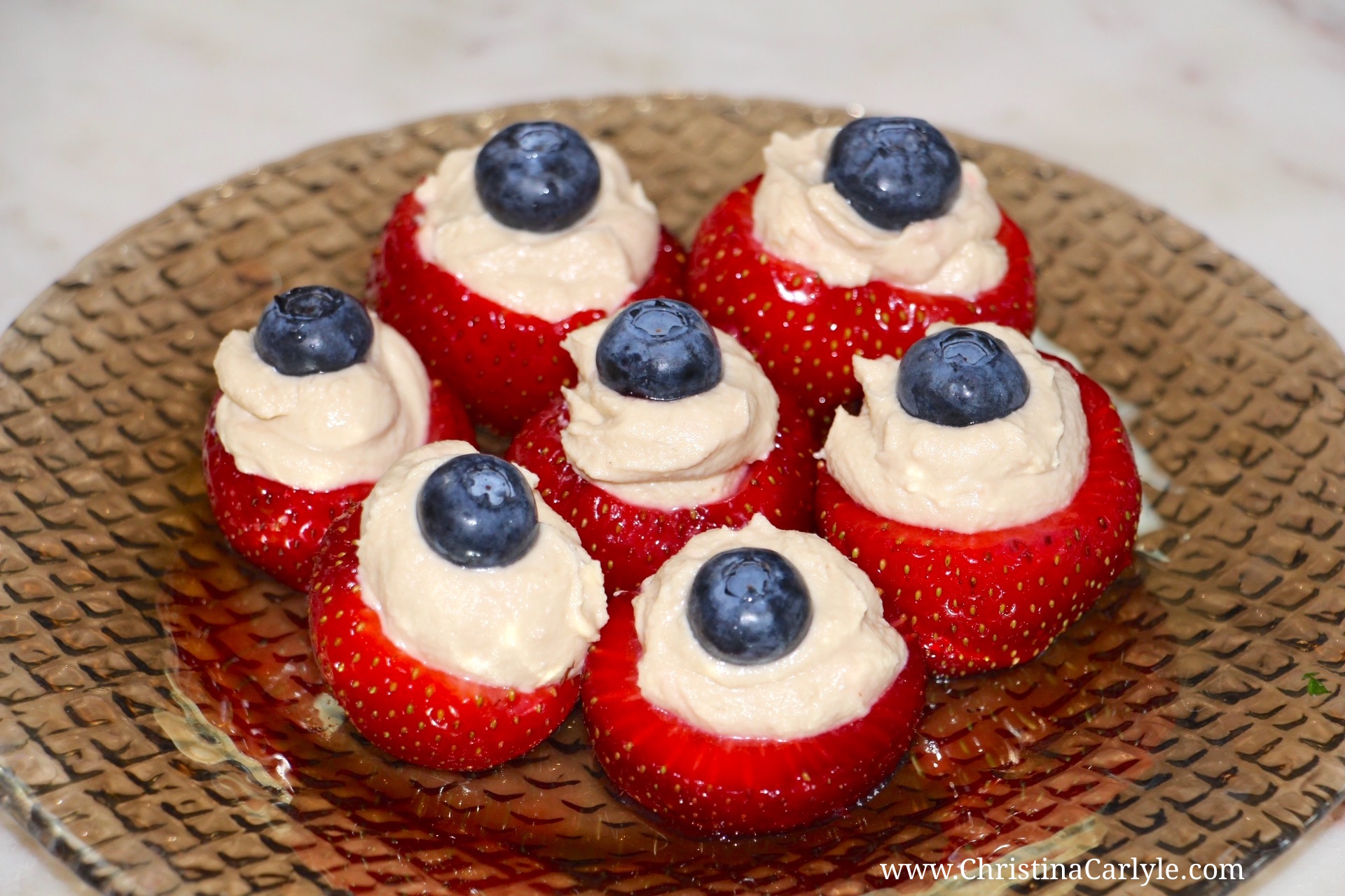 Red white and Blue Hummus Blueberry and Strawberry Bites Recipe | Healthy 4th of July Recipes from nutritionist Christina Carlyle https://christinacarlyle.com/healthy-4th-of-july-recipes/